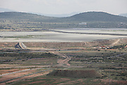 A tailings dam that holds the polluted water left over from processing platinum ore now covers the village&rsquo;s agricultural land. The dam will extend up the valley to cover natural springs and wetlands. Environmental researchers from WITS University predict that once the tailings enter the wetlands it will pollute the underground water and contaminate Sekuruwe's boreholes.<br /> <br /> Sekururwe is small community in Limpopo. They lost most of their agricultural land in 2005 when it was leased to a platinum mine. These photographs were taken as the community fought to get further compensation from the mine. They believe they were not fully involved in the consultation process or made aware of the affects the mine would bring to the economy of the village, their way of life, their ancestral graves and underground water.<br /> <br /> As a result of negotiations initiated by the Legal Resources Centre the mine made a substantial offer for financial compensation in 2011. South African law stipulates that consent must be gained before mining on communal land yet it is unclear how and whom this consent is gained from.<br /> <br /> &copy;Zute &amp; Demelza Lightfoot / Legal Resources Centre