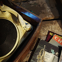An old 1950's record player with sheet music