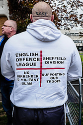 An English Defence League member arrives at a rally in Waltham Forest. Walthamstow London May 2015