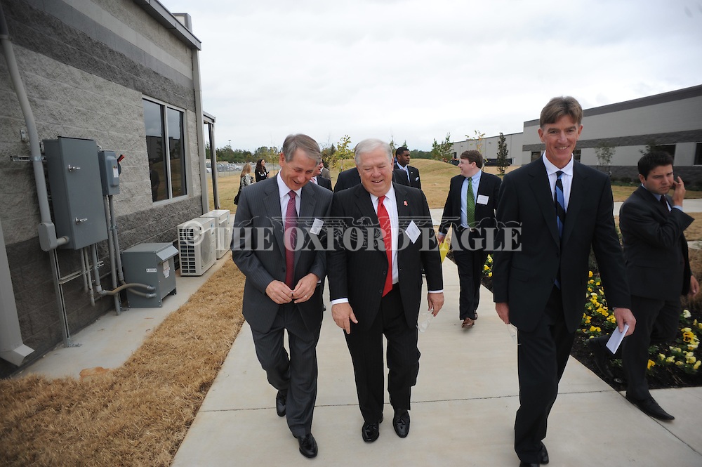 Olin Corporation CEO Joseph Rupp (left), Mississippi governor Haley Barbour (center), and Thomas O'Keefe (right), president of Winchester Ammunition, at a ribbon cutting for its Centerfire Ammunition Plant in Oxford, Miss. on Wednesday, October 12, 2011.  The expansion of Winchester's Mississippi operations is expected to create nearly 1,000 new jobs either directly or indirectly in Oxford by 2016 when the plant is fully operational.