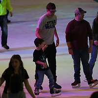 Libby Ezell | BUY AT PHOTOS.DJOURNAL.COM<br /> Reed Nunnelee of Brandon takes his son, Thomas aged 6, ice skating for the first time