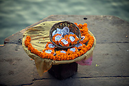 A basket with flower offerings for sale.<br />