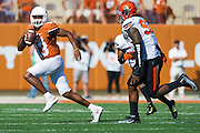 AUSTIN, TX - SEPTEMBER 26:  Jerrod Heard #13 of the Texas Longhorns scrambles against the Oklahoma State Cowboys on September 26, 2015 at Darrell K Royal-Texas Memorial Stadium in Austin, Texas.  (Photo by Cooper Neill/Getty Images) *** Local Caption *** Jerrod Heard