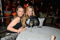 PICTURE SHOWS:-Left to right, SOPHIE MOSS and OLIVIA HUNT.<br /> Tuesday 14th April 2015 saw a host of London influencers and VIP faces gather together to celebrate the launch of The Ivy Chelsea Garden. Live entertainment was provided by jazz-trio The Blind Tigers, whilst guests enjoyed Moët & Chandon Champagne, alongside a series of delicious canapés created by the restaurant's Executive Chef, Sean Burbidge.<br /> The evening showcased The Ivy Chelsea Garden to two hundred VIPs and Chelsea<br /> residents, inviting guests to preview the restaurant and gardens which marry<br /> approachable sophistication and familiar luxury with an underlying feeling of glamour and theatre. The Ivy Chelsea Garden's interiors have been designed by Martin Brudnizki Design Studio, and cleverly combine vintage with luxury, resulting in a space that is both alluring and down-to-earth.