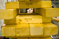 (El Puerto de Santa Maria, Spain - August 25, 2010) - On the last Casino Night of camp, a camper looks up plotting her next move in Giant Jenga. ..Photo by Will Nunnally / TECS