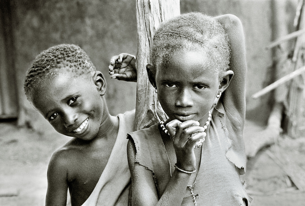Gambian village children boy and girl in the up river Mandinka peoples village of Keneba, The Gambia, West Africa.