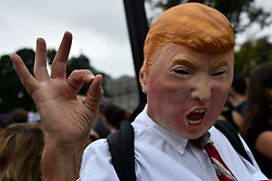 October 6, 2018 - Washington, DC, United States - Protestor in a Trump mask gesturers at a rally against the expected confirmation of Judge Brett Kevanaugh, near the steps of the US Supreme Court, in Washington D.C., on  October 6, 2018. (Credit Image: © Bastiaan Slabbers/NurPhoto/ZUMA Press)