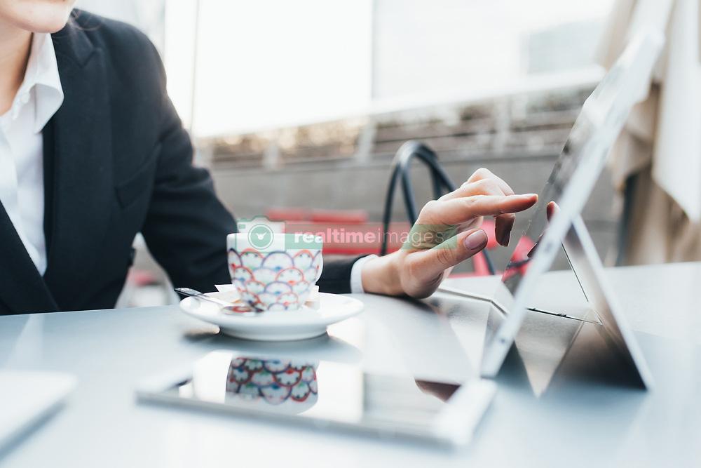 February 24, 2017 - Businesswoman using digital tablet in coffee shop (Credit Image: © Eugenio Marongiu/Image Source via ZUMA Press)