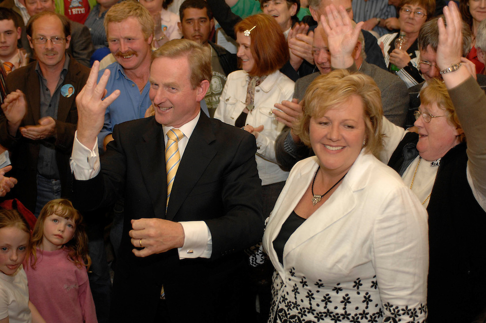 Enda Kenny signals three seats at the TF Royal, Mayo Count Centre with wife Fionula and supporters. Pic: Michael Mc Laaughlin