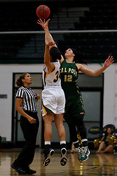 Nov 16, 2011; San Francisco CA, USA;  Cal Poly Mustangs forward Kristina Santiago (12) wins the opening tip off over San Francisco Lady Dons forward Whitney Daniels (34) before the game at War Memorial Gym.  Mandatory Credit: Jason O. Watson-US PRESSWIRE