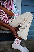 "Mattie Mae Brown, 66, shows her socks, professing that ""Jesus is the Way"" in Baptist Town, Mississippi on Wednesday, May 19, 2010."