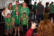 A groups stops for a picture during the St. Patrick's Day celebration at the Dublin Pub in downtown Dayton, Saturday, March 17, 2012.