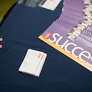 Literature on display at a temp staffing agency's booth at a job fair in Arlington, VA on Friday, Jan. 15, 2010.