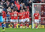 Bristol City players celebrate after Bristol City forward Lee Tomlin (9) makes it 3-0 with a penalty during the Sky Bet Championship match between Bristol City and Sheffield Wednesday at Ashton Gate, Bristol, England on 9 April 2016. Photo by Adam Rivers.