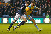Millwall midfielder Ben Marshall (44) heads the ball just wide of the post during the EFL Sky Bet Championship match between Millwall and Rotherham United at The Den, London, England on 2 February 2019.