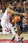 FAYETTEVILLE, AR - DECEMBER 19:  Dee Oldham #1 of the UT Martin Skyhawks is fouled driving to the basket by Rickey Scott Jr. #3 of the Arkansas Razorbacks at Bud Walton Arena on December 19, 2013 in Fayetteville, Arkansas.  The Razorbacks defeated the Skyhawks 102-56.  (Photo by Wesley Hitt/Getty Images) *** Local Caption *** Dee Oldham; Rickey Scott Jr.