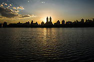 Sunset over the Reservoir in Central Park with a view of the El Dorado apartment towers