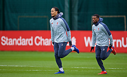 LIVERPOOL, ENGLAND - Tuesday, March 12, 2019: Liverpool's Virgil van Dijk (L) and Georginio Wijnaldum during a training session at Melwood Training Ground ahead of the UEFA Champions League Round of 16 1st Leg match between FC Bayern München and Liverpool FC. (Pic by Laura Malkin/Propaganda)