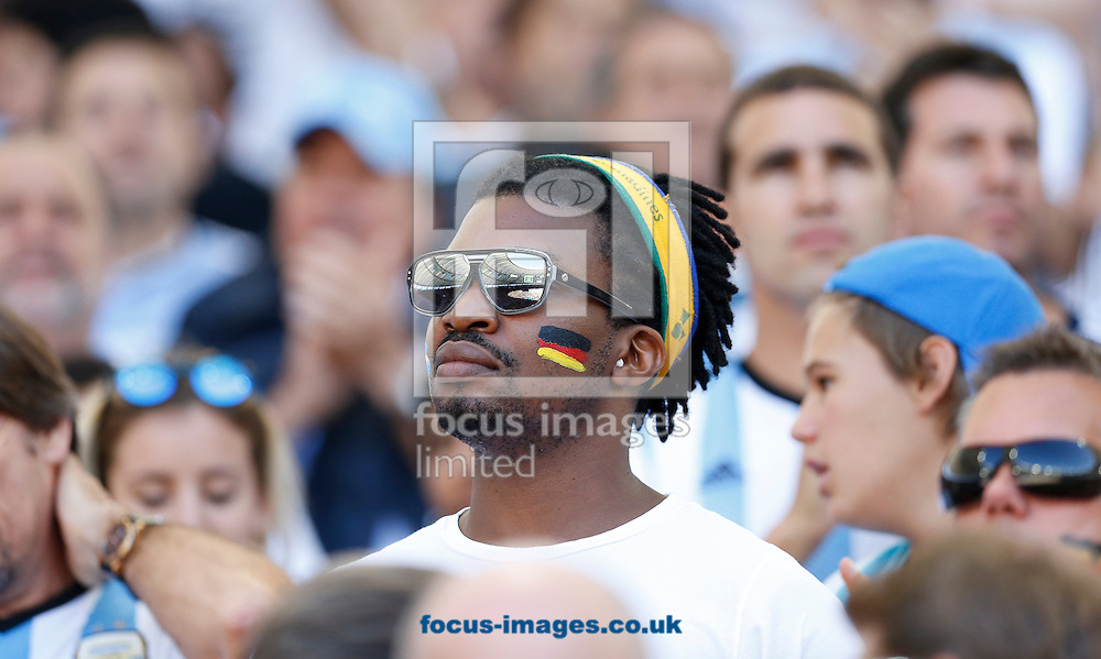 A Germany fan during the 2014 FIFA World Cup Final match at Maracana Stadium, Rio de Janeiro<br /> Picture by Andrew Tobin/Focus Images Ltd +44 7710 761829<br /> 13/07/2014