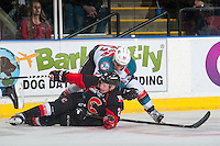 KELOWNA, CANADA - FEBRUARY 18: Devante Stephens #21 of the Kelowna Rockets checks Jared Bethune #21 of the Prince George Cougars to the ice during first period on February 18, 2017 at Prospera Place in Kelowna, British Columbia, Canada.  (Photo by Marissa Baecker/Shoot the Breeze)  *** Local Caption ***