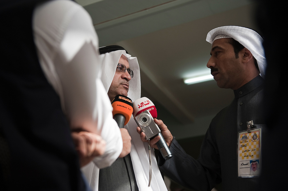 "Kuwaiti Justice, Education and Higher Education Minister Ahmad Al-Mulaifi talks to reporters after touring polling stations in Kuwait City during the Feb. 2 , 2012 parliamentary elections. The minister told reporters that he was confident that the voting process would run smoothly. ""Our democracy is an open book for all,"" the minister was quoted as saying by local media.  A total of 400,296 Kuwaiti men and women are eligible to vote to choose from among some 285 candidates, including more than 20 women candidates, for a new 50-seat parliament."