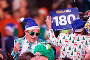 Darts fans in their Christmas outfits, fancy dress, during the Darts World Championship 2018 at Alexandra Palace, London, United Kingdom on 18 December 2018.