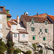 A row of charming stone houses built on top of rock in Split, Croatia.