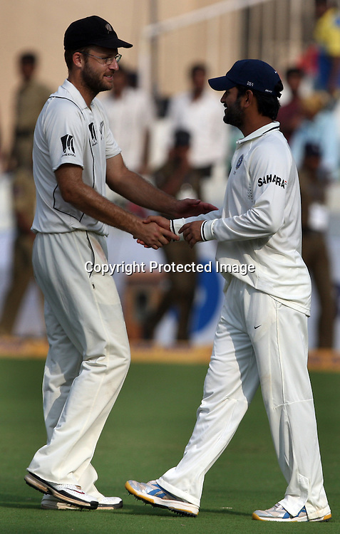 Indian captain MS Dhoni shekh hand with New Zealand Captain Daniel Vettori after end of the day during the Indian vs New Zealand 2nd test match day-5 Played at Rajiv Gandhi International Stadium, Uppal, Hyderabad 16 November 2010 (5-day match)
