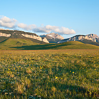 the rocky mountain front rises high above the montana prairie