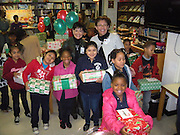 Students participate in the Crawford-Sherman ES gift drive, a partnership between Crawford-Sherman, Hallmark retirement facility, and Mount Vernon United Methodist Church. The partnership delivered a gift to every student, as well as distributed cookies and juice.<br /> To submit photos for inclusion in eNews, send them to hisdphotos@yahoo.com.