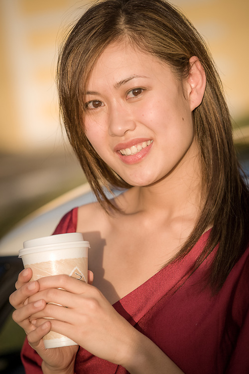 Asian, young woman, portrait on location, outdoors.