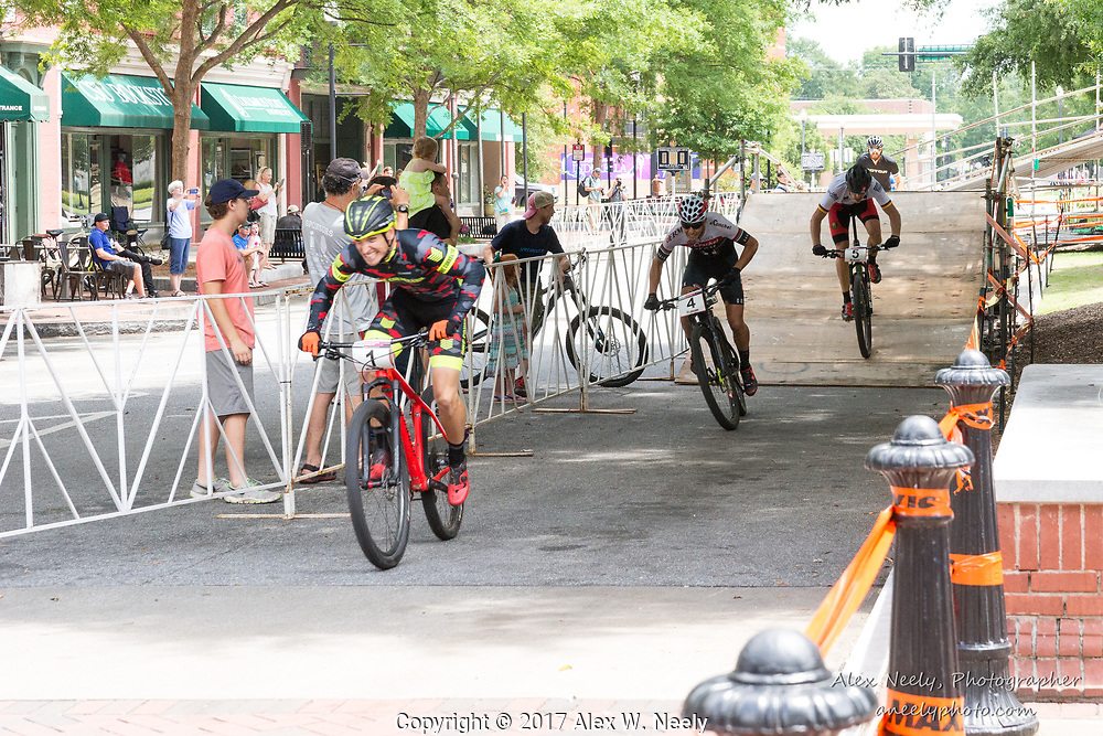 Simon Rogier (#1 FRA) leads Alberto Mingorance Fernández (#4 ESP), Simon Gegenheimer (#5 GER) and Matt Clements (#8 USA) during second heat of the 1/2 finals during Round 2 of the 2017 UCI MTB Eliminator World Cup held in Columbus, GA, USA on June 4, 2017.