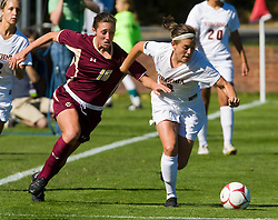 Virginia Cavaliers midfielder/defender Alli Fries (8) fends off Boston College Eagles forward Brooke Knowlton (16).  The #9 ranked Virginia Cavaliers defeated the #13 ranked Boston College Eagles 2-1 in NCAA women's soccer at Klockner Stadium on the Grounds of the University of Virginia in Charlottesville, VA on October 19, 2008.
