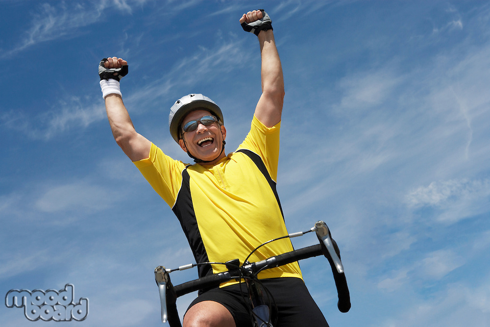Happy Cyclist Cheering with Arms Raised
