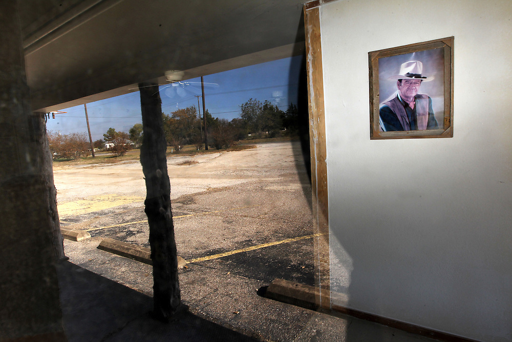 A photo of John Wayne still hangs in the lobby of the vacant Fink Hotel November 18, 2010.  (Courtney Perry/The Dallas Morning News) 11202010xNEWS