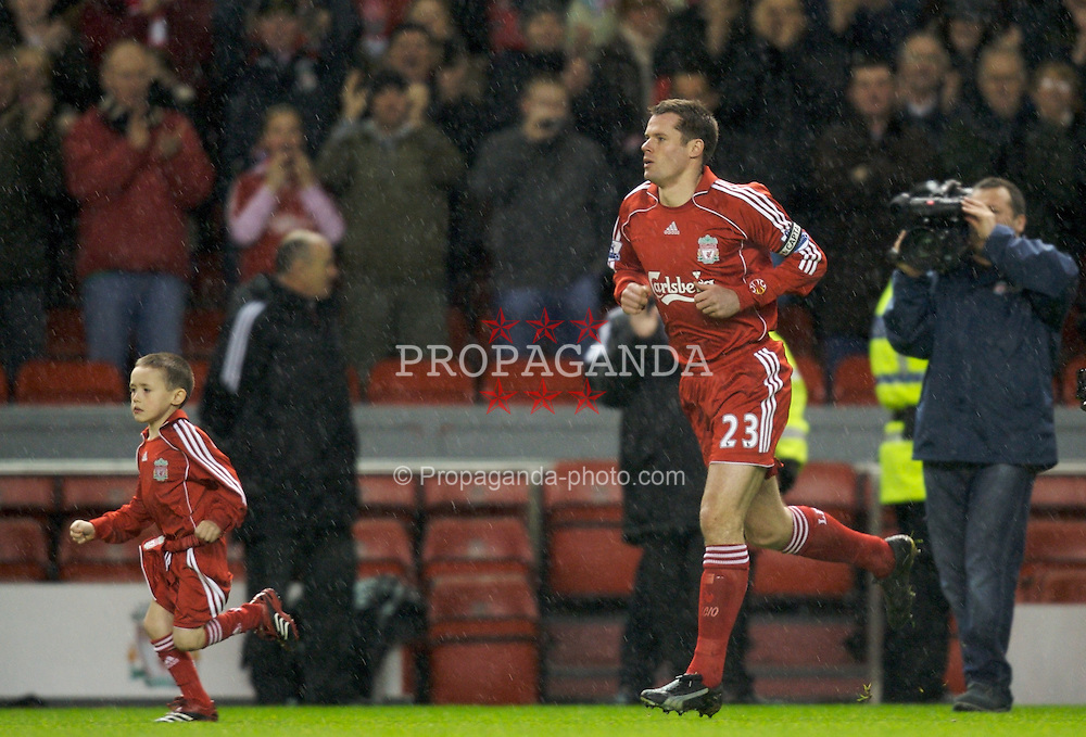 LIVERPOOL, ENGLAND - Tuesday, January 15, 2008: Liverpool's Jamie Carragher runs with his son out to applause before making his 500th appearance for the Reds during the FA Cup 3rd Round Replay against Luton Town at Anfield. (Photo by David Rawcliffe/Propaganda)