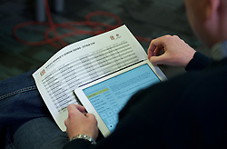 CARDIFF, WALES - Thursday, February 19, 2015: A reporter looks at theWales women's squad list during a press conference ahead of the 2015 Istria Cup at the FAW HQ in Cardiff. (Pic by Carl Robertson/Propaganda)