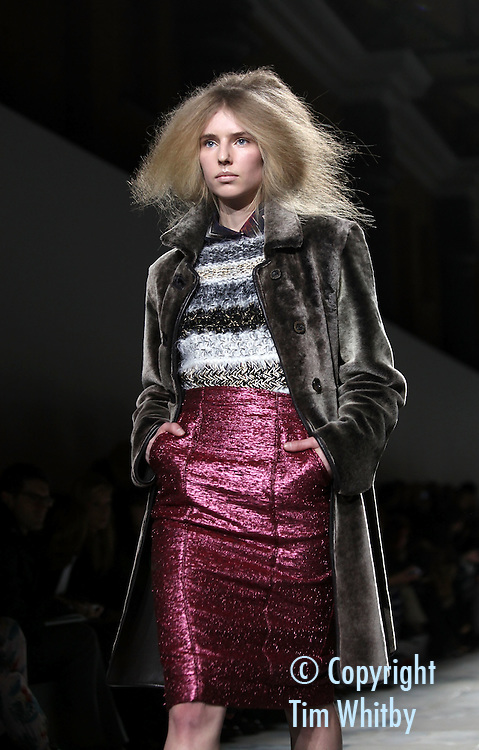 LONDON, ENGLAND - FEBRUARY 20:  A model walks the runway during the Fashion East show at London Fashion Week Autumn/Winter 2012 at Topshop Venue, Old Billingsgate Market  on February 20, 2012 in London, England  (Photo by Tim Whitby/Getty Images)