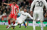 Real Madrid's Sergio Ramos against Almeria's JM Ortiz during La Liga match, November 05, 2009.