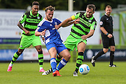 Gateshead's Mitch Brundle(8) tangles with Forest Green Rovers Aarran Racine (21) during the Vanarama National League match between Forest Green Rovers and Gateshead at the New Lawn, Forest Green, United Kingdom on 13 August 2016. Photo by Shane Healey.