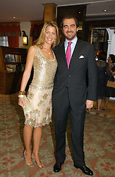 PRINCE NICKOLAS OF GREECE and close friend TATIANNA BLACKNICK at a private view of the forthcoming sale 'Property from the collection of HRH The Princess Margaret, Countess of Snowdon' and a private view of art by Marina Karella Princess Michael of Greece, held at Christie's, 8 King Street, London SW1 on 12th June 2006.<br />