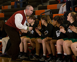 William Monroe head coach Philip Lamb motivates his team.  The Charlottesville High School Lady Black Knights defeated the William Monroe High School Dragons 48-45 in girls basketball at the CHS Gymnasium in Charlottesville, VA on December 19, 2008.  (Special to the Daily Progress / Jason O. Watson)