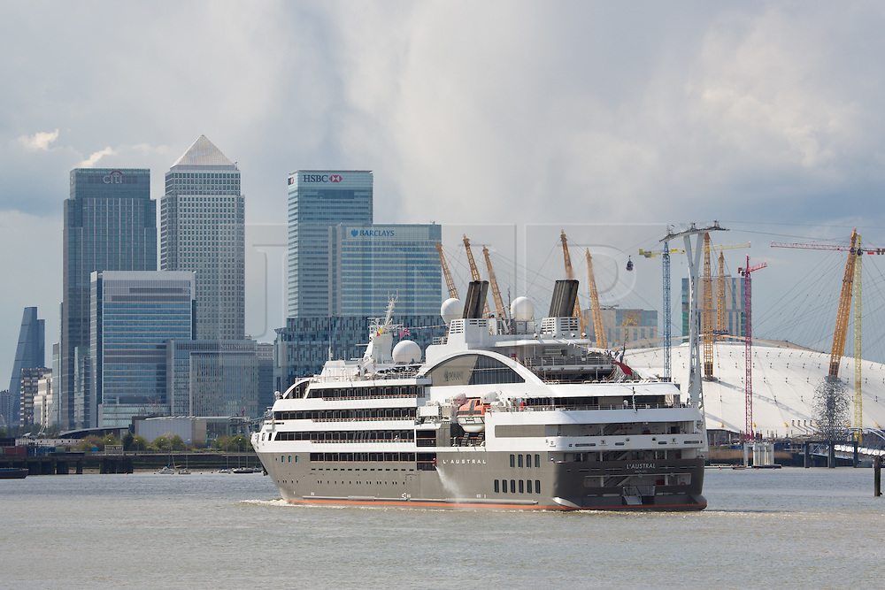 © Licensed to London News Pictures. 30/04/2016. London's cruise season has got under way with the arrival of the first cruise liner in the capital this year L'Austral sailed up the Thames this afternoon where she moored alongside HMS Belfast. The French cruise ship is 142 metres long - about the same length as 14 London buses. Clean air campaigners have recently won a Judicial Review into a decision to build a new cruise liner terminal in London at Greenwich. The arrival occured on a sunny, spring Bank holiday Saturday. Credit: Rob Powell/LNP