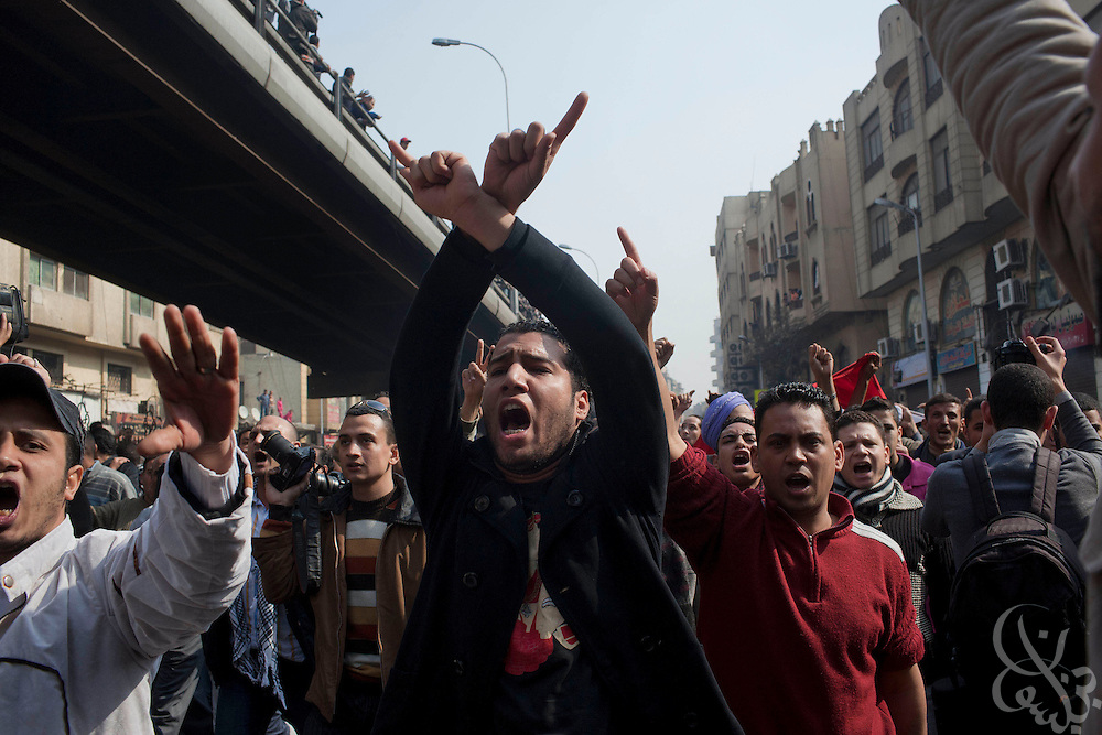 Egyptian protesters march down Al-Azhar street during massive and unprecedented demonstrations January 28, 2011 across Cairo, Egypt . The protests, inspired by the recent revolution in Tunisia, have struck a chord with Egypt's population, tired of inflation, high unemployment and alleged corruption within the Mubarak government..Slug: Egypt.Credit: Scott Nelson for the New York Times