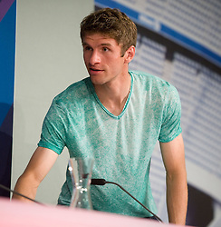14.05.2013, Allianz Arena, Muenchen, GER, UEFA CL, FC Bayern Muenchen, Medientag, im Bild Thomas MUELLER (FC Bayern Muenchen) kommt zu frueh zur Pressekonferenz // during the open media day of FC Bayern Munich in front of the UEFA Champions League Final 2013 held at the Alianz Arena, Munich, Germany on 2013/05/14. EXPA Pictures © 2013, PhotoCredit: EXPA/ Eibner/ Wolfgang Stuetzle..***** ATTENTION - OUT OF GER *****