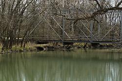 Swisher Bridge, a steel beam one lane bridge over a stream leading to Clinton Lake.