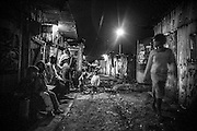 Night scene at the top end of Kawangware Street, the most notorious street for rapes. Since the installation of the flood light further down in December 2012, a joint initiative of the Kenya Government and Safaricom who pay the electricity fee, the incidences of rape have been reduced. <br />