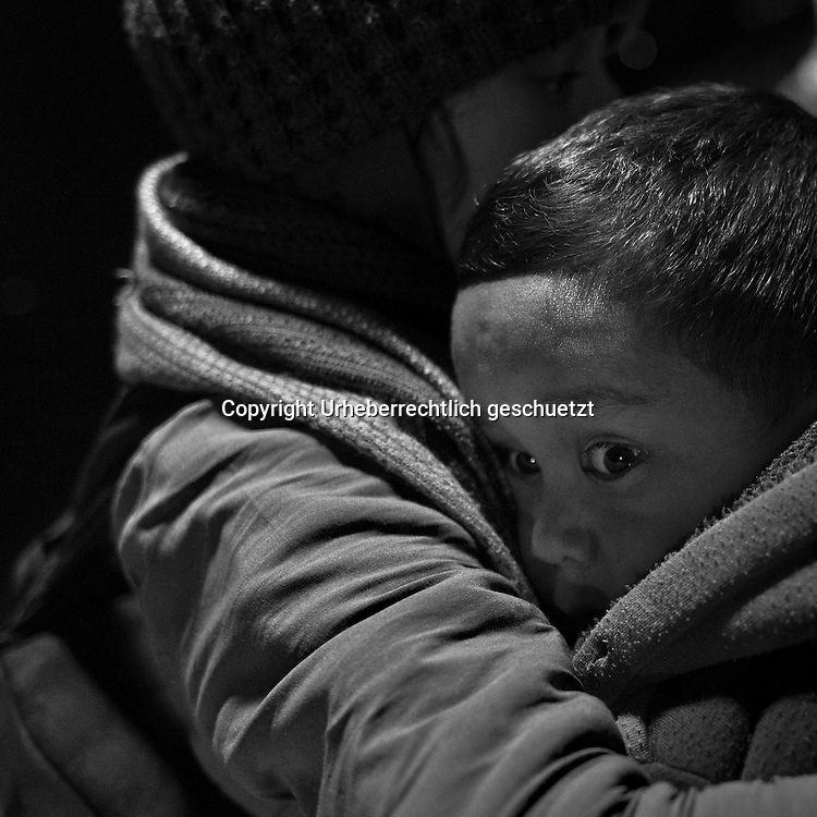 Greece, Chios, The Odyssey. It Does Not Ends Here 8<br /> <br /> The cap, the rescue blanket, the little girl and the cold night by the sea<br /> <br /> A little girl wrapped with a rescue blanket, is waiting in the cold night at the shore. Refugees - a few minutes after arriving at the coast in Chios, near Karfaz. They came from Cesme, Turkey with a dinghy and with fake life jackets at night. Depending on the sea, it takes them between three to five hours to cross the Aegean Sea between Turkey and Greece, depending where they start, its about minimum 8 nautical miles between coast to coast. Refugees from Afghanistan, Iran, Syria and other countries form the near east, made it to Greece by crossing the Aegean Sea with a rubber dinghy.