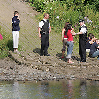 Tay River Accident...13.7.2005.<br /> Police talk to and comfort teenagers at the scene.  Believed to be friends of the victim.<br /> (Please see Gordon Currie story 01738 446766).<br /> <br /> NO BYLINE TO BE USED WITH IMAGE.<br /> Picture by John Lindsay<br /> COPYRIGHT: Perthshire Picture Agency.<br /> Tel. 01738 623350 / 07775 852112.