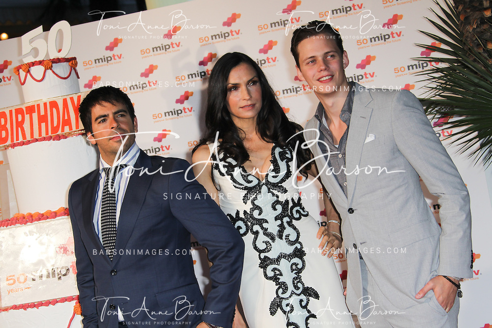 CANNES, FRANCE - APRIL 08:  Eli Roth, Famke Janssen and Bill Skarsgard arrive at the MIPTV 50th Anniversary : Opening Party at the Martinez Hotel on April 8, 2013 in Cannes, France.  (Photo by Tony Barson/Getty Images)